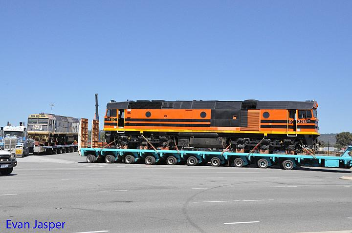 DC2215 and 42211 on the back of a truck seen here leaving Forrestfield for fremantle to be shipped to South Africa taken on the 6th January 2015
