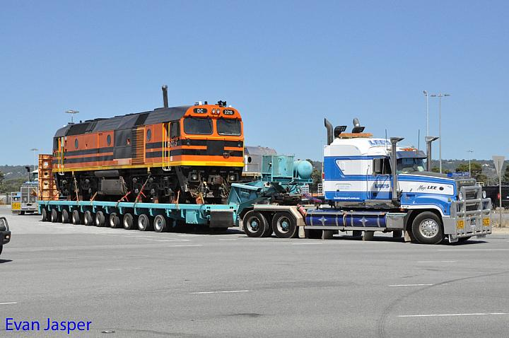 DC2215 on the back of a truck seen here leaving Forrestfield for fremantle to be shipped to South Africa taken on the 6th January 2015