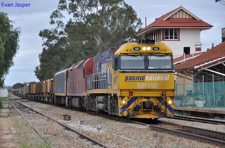 NR110 and AN3 on 2NP3 loaded steel train at Merredin on the 22nd September 2011