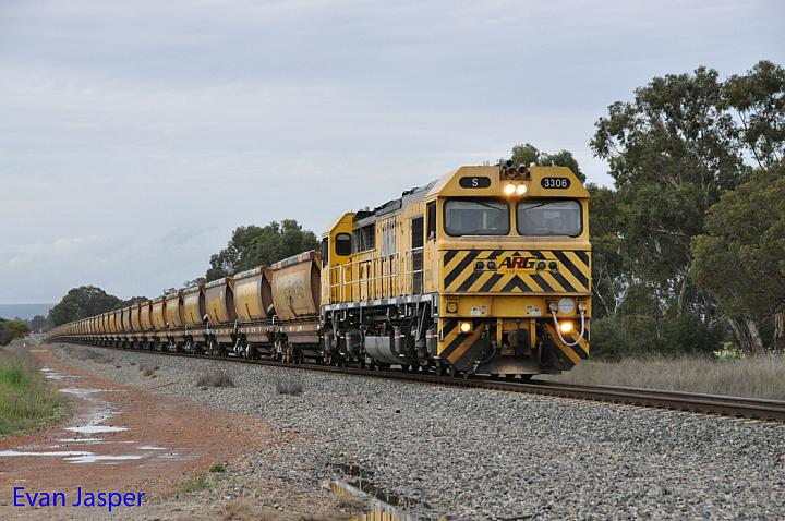 S3306 on 7953 empty bauxite train is seen here powering though North Pinjarra on the 30th August 2014