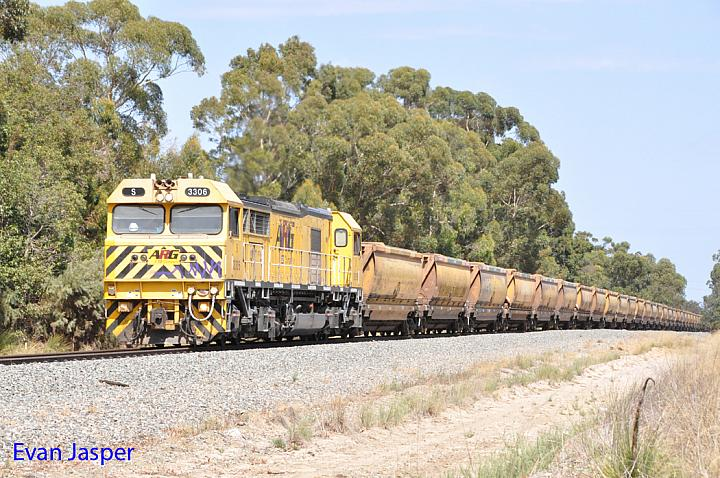 S3306 on 6962 loaded bauxite train seen here powering though North Pinjarra on the 18th March 2016