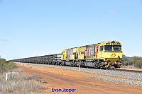 ACN1446 and ACN4170 on 2763 loaded Karara iron ore train seen here heading though Curara on the 1st July 2019