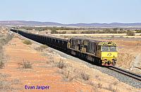 ACN4143 and ACN4142 on 1765 loaded Karara iron ore train seen here heading though the outskirts of Morawa on the 26th January 2020