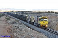 ACN4172 and ACN4148 on 2765 loaded Karara iron ore train seen here heading though outskirts of Morawa on the 1st July 2019