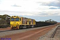 ACN4172 and ACN4148 on 2765 loaded Karara iron ore train seen here heading though Pintharuka on the 1st July 2019