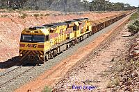 AC4303 and ACB4405 on 6413 loaded iron ore train seen here powering away from Binduli after a crew change on the 30th March 2018