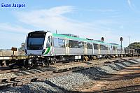 Transperth newiest B set 107 on the back of 5MP2 steel train at Meckering on the 31st May 2015