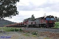 MRL002 and MRL004 on 3030 loaded MRL iron ore train seen here powering though Brigadoon on the 10th August 2016