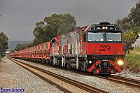 MRL002 and MRL005 on 1030 loaded iron ore train seen here powering though Thornlie on the 7th September 2014