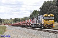 NR11 and MRL002 on 1030 loaded MRL iron ore train seen here at Hazelmere on the 18th October 2015