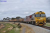 NR110 and AN3 on 2NP3 loaded steel train at West Merredin on the 22nd September 2011