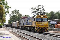 NR13 and NR35 on 1MP2 loaded steel train seen here heading though Merredin on the 10th January 2018