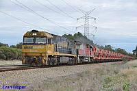 NR19 and MRL002 on 3030 loaded MRL iron ore train seen here powering though Stratton on the 29th April 2015