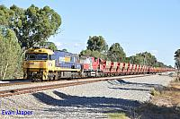 NR77 and MRL001 on 7035 empty MRL iron ore train seen here heading though Hazelmere on the 5th March 2016