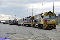 NR9 and 8118 sits at Perth Freight Yard Kewdale on the 10th September 2014