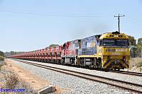 NR92 and MRL004 on 7030 loaded MRL iron ore train seen here powering though Meckering on the 1st November 2014