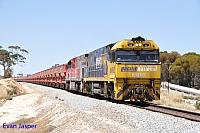 NR92 and MRL004 on 7030 loaded MRL iron ore train seen here powering though Meenar on the 1st November 2014
