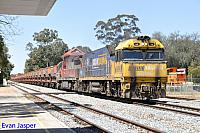 NR96 and MRL004 on 4030 loaded MRL iron ore train seen here powering though Merredin on the 12th October 2016