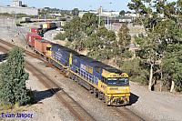NR99 and NR86 on 1PS6 freighter seen here departing Perth Freight Terminal Kewdale on the 22nd March 2020