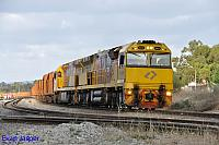 ACC6031 and ACC6030 on 7030 loaded MRL iron ore train seen here heading though Kewdale on the 23rd November 2013