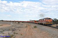 GM43 and GM42 on 1M21S loaded ballast train see here powering though Long Plains (SA) on the 14th April 2015