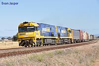 NR95 and NR23 on 6MP5 freighter seen here powering though Two Wells for Perth on the 16th November 2013