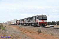 SCT001, SCT004 and SCT008 on 2MP9 SCT freighter seen here powering though Korunye on the 14th April 2015