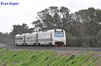 ADP103/ADQ121/ADP101 on 1209 Australind Service is seen here crossing the Collie River bridge near Burekup heading for Bunbury Station on the 28th June 2020