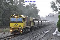 In the downpour ACN4152 powers 2871 Alumina service though Waroona for Bunbury Harbour on the 29th June 2020