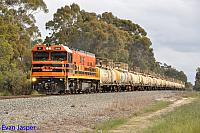 P2513 on 7938 caustic train is seen here powering though North Pinjarra on the 30th August 2014