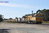 S3303 on 3971 empty bauxite train seen here heading though Pinjarra on the 27th August 2019