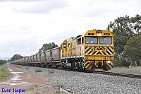S3303 on 7943 empty bauxite train seen here heading though Pinjarra North for Calcine on the 30th August 2014