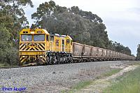 S3303 on 7944 loaded bauxite train is seen here powering though North Pinjarra on the 30th August 2014