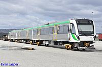 Transperth B set 102 awaits it turn to be hauled to Midland for Bogie transfer seen here at Perth freight Terminal Kewdale on the 10th September 2014