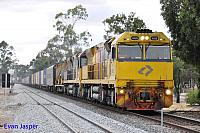 6029 and 6008 on a late running 5MP1 freighter seen here rolling though Northam for Perth on the 1st December 2013