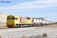 Q4007 on 3197 loaded cement/lime train seen here rolling though Forrestfield South on the 26th December 2017