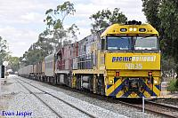 NR35 and NR74 on 4WP2 steel train seen here rolling though Northam for Perth on the 1st December 2013